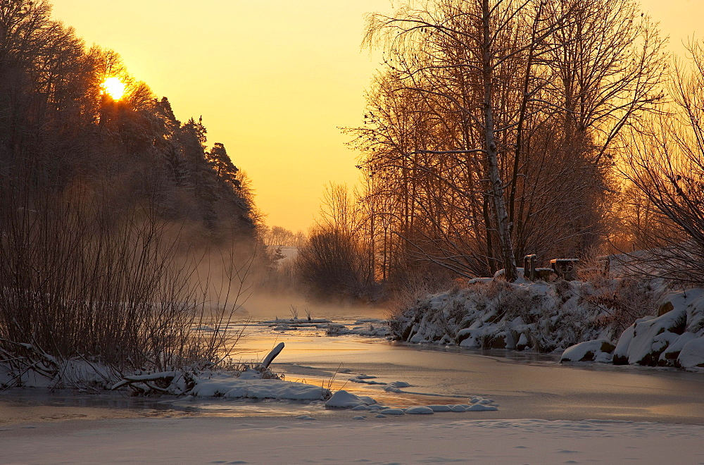 Winter morning on a frozen river with a bench at sunrise, Feistritz near Herberstein, Styria, Austria, Europe