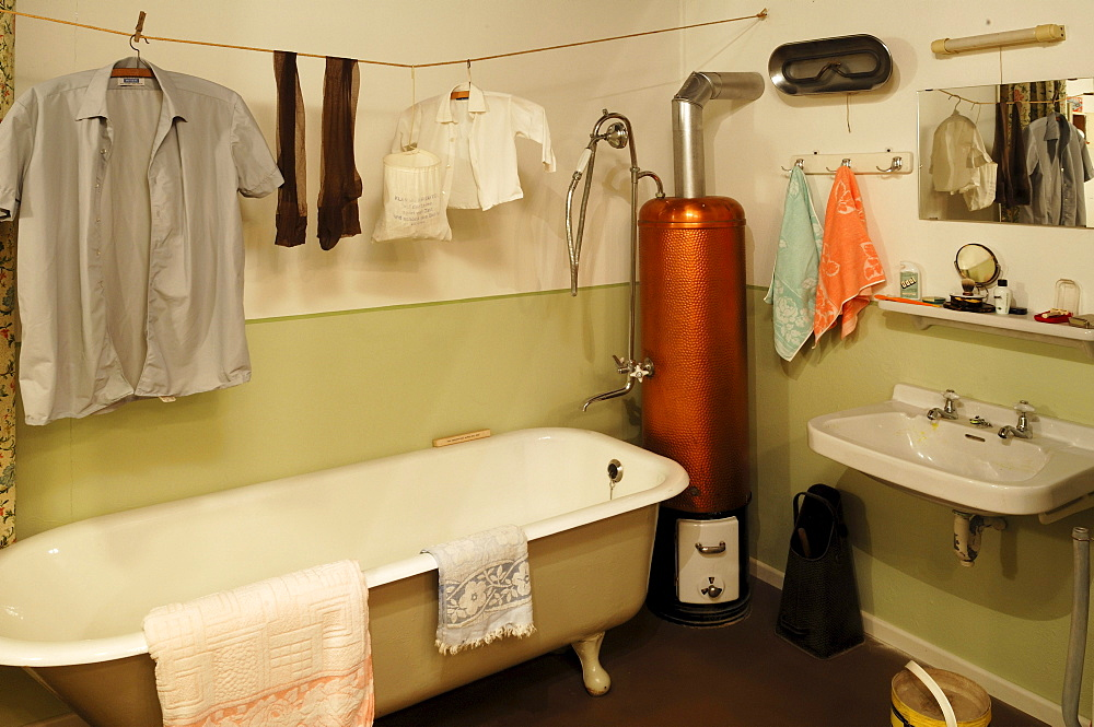 Bathroom from the 1950s with laundry hanging, a bathtub and a water heater, 1950s Exhibition 2010-2011, German Salt Museum, Suelfmeisterstrasse 1, Lueneburg, Lower Saxony, Germany, Europe