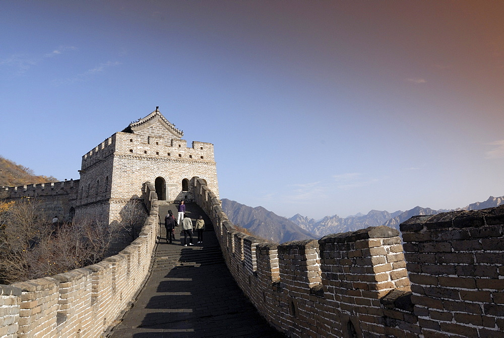 Tourists walking towards a guard tower on the Great Wall of China at Mutianyu in autumn, UNESCO World Heritage Site, near Beijing, China, Asia