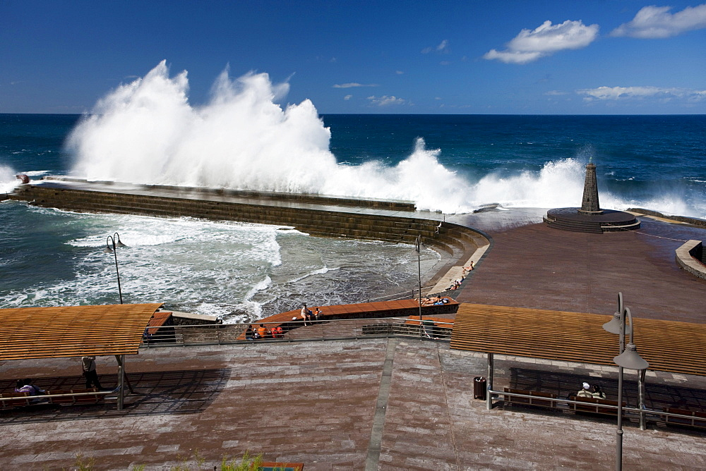 High waves breaking at the sea water swimming pool in Bajamar, Tenerife, Spain, Europe