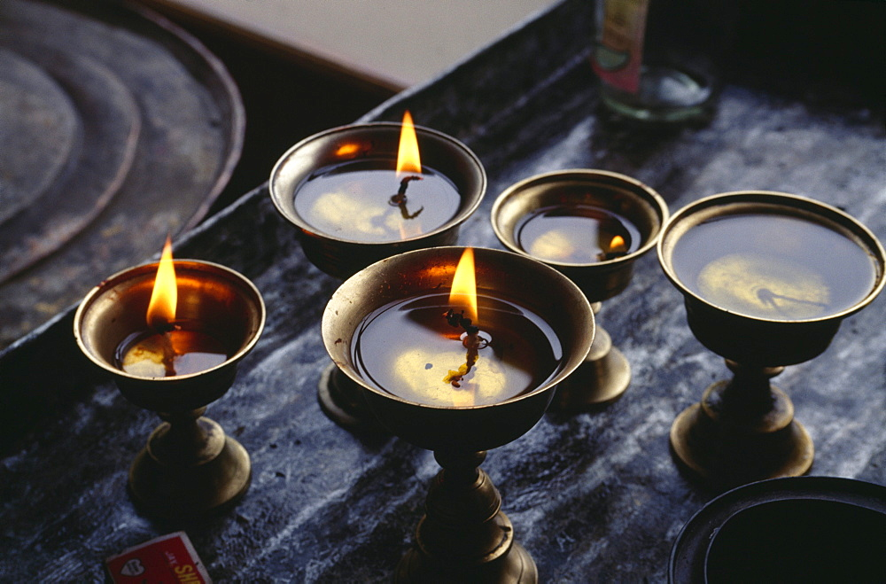 Butter lamps in the monastery Phyang, Ladakh, Jammu and Kashmir, India, Asia