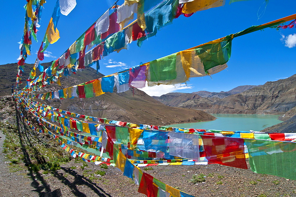 Prayer flags at a reservoir on the Karo-La Pass on the Friendship Highway, Tibet, Asia