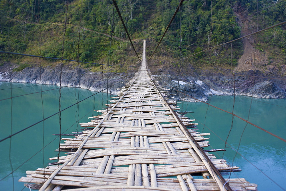 Long suspension bridge made of palm wood spanning the Siang River, Arunachal Pradesh, North East India, India, Asia