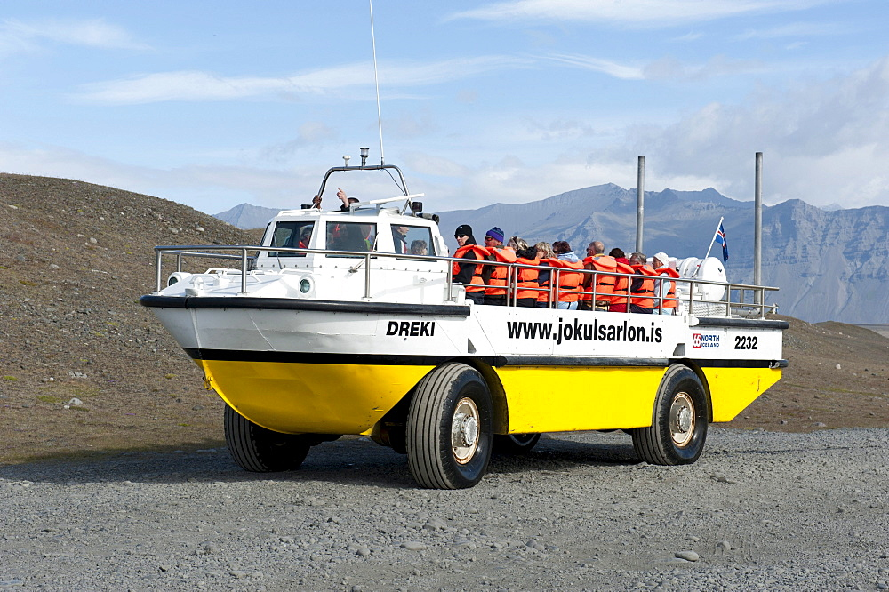 Amphibious vehicle driving on land, converted American LARC-5, tourists on board, Joekulsarlon glacial lake, Joekulsarlon, Iceland, Scandinavia, Northern Europe, Europe