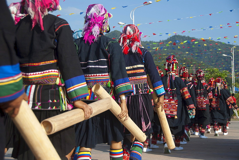 Women of the Akha ethnic minority from the province of Phongsali in Laos marching in colourful costumes with bamboo tubes at a festival, Jiangcheng, Pu'er City, Yunnan Province, People's Republic of China, Southeast Asia, Asia