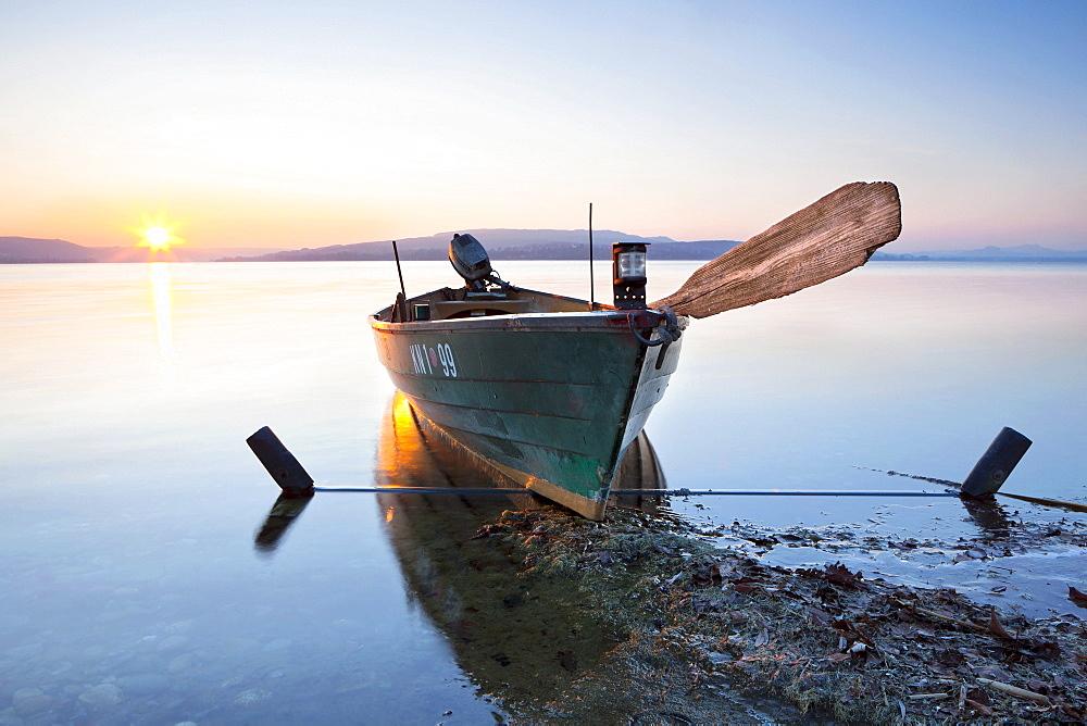 Evening mood with fishing boat on Reichenau island, Baden-Wuerttemberg, Germany, Europe