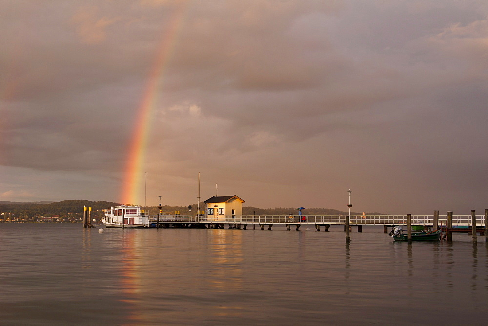 Pier on Lake Constance in Dingelsdorf with a rainbow on the horizon, Baden-Wuerttemberg, Germany, Europe
