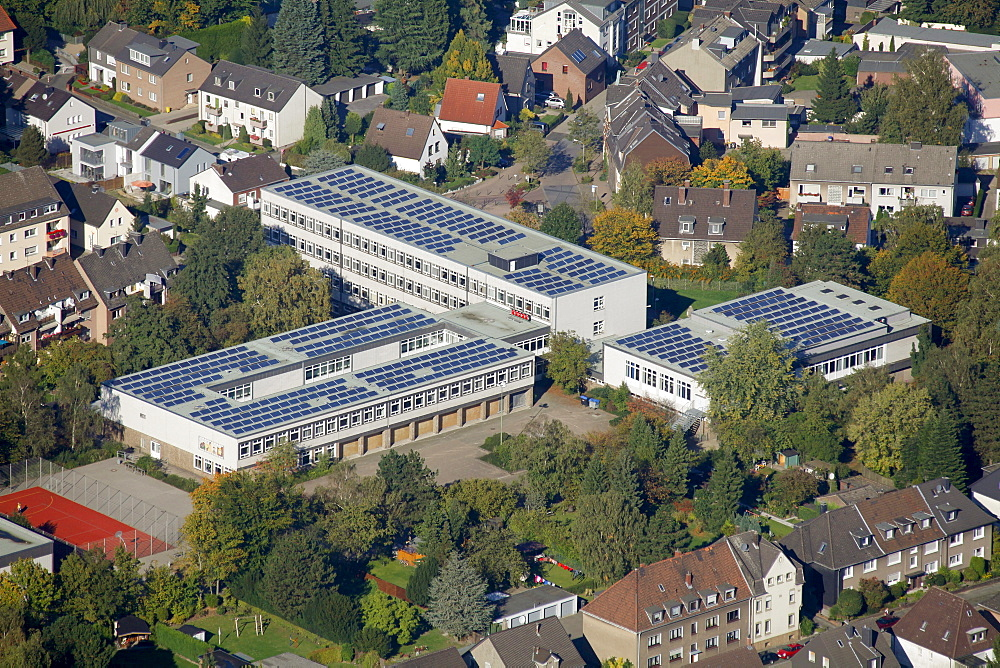 Aerial view, solar cells on the roof of a high school, Bottrop, Ruhr Area, North Rhine-Westphalia, Germany, Europe