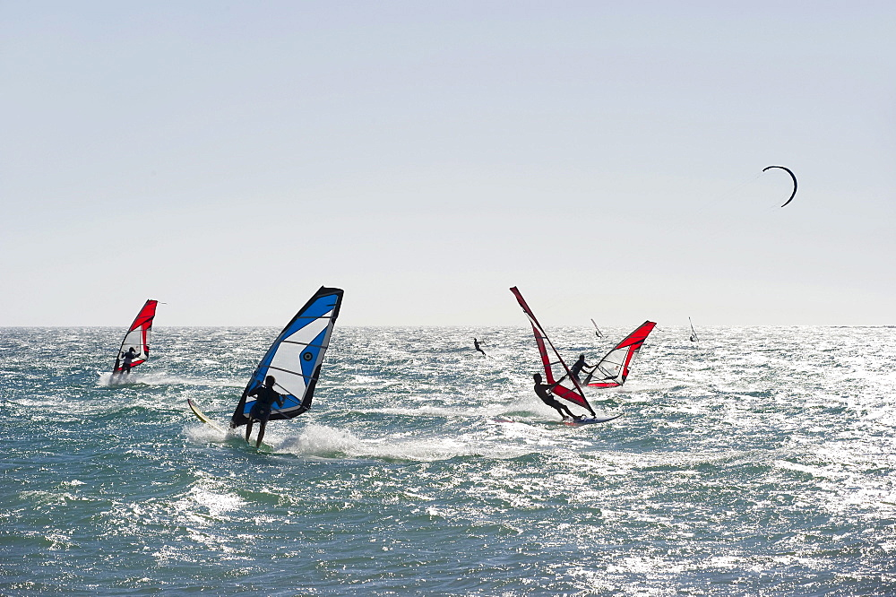 Wind surfers and kite surfers surfing near Tarifa, Costa del Luz, Andalucia, Spain, Europe