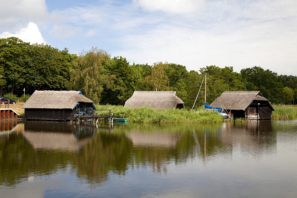 Boat houses on the Prerower Strom estuary, Fischland-Darss-Zingst peninsula, Mecklenburg-Western Pomerania, Germany, Europe
