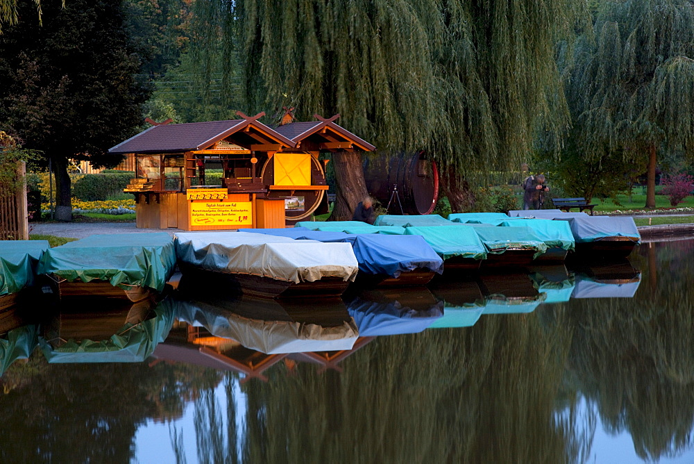 Small kahn boats at twilight, Luebbenau, Spreewald, Brandenburg, Germany, Europe