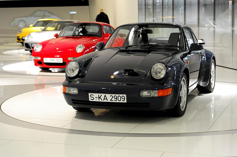 Porsche 911 models, Porsche 911 Turbo 3.0 Coupe in front, Porsche Museum, Stuttgart, Baden-Wuerttemberg, Germany, Europe