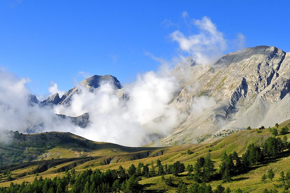 Fog rising over Col des Champs, Mercantour National Park, Haute Verdon mountains, Alpes de Haute Provence, France, Europe