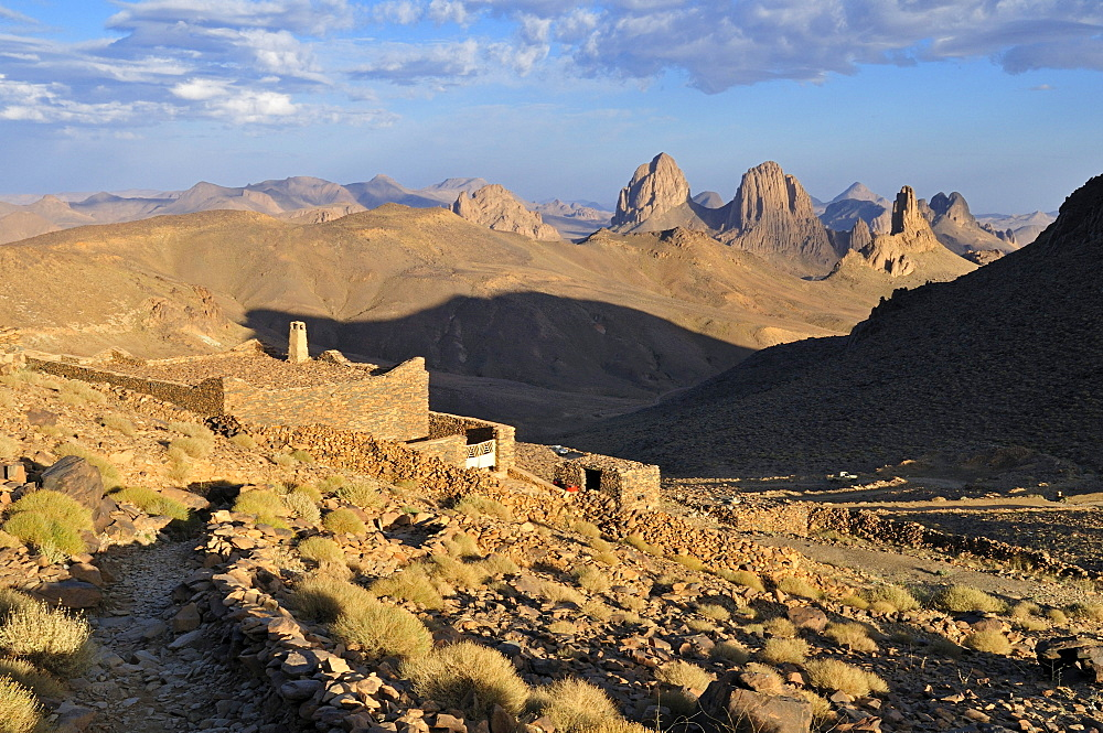 Building on Assekrem with view over the volcanic landscape of Atakor, Hoggar, Ahaggar Mountains, Wilaya Tamanrasset, Algeria, Sahara, North Africa