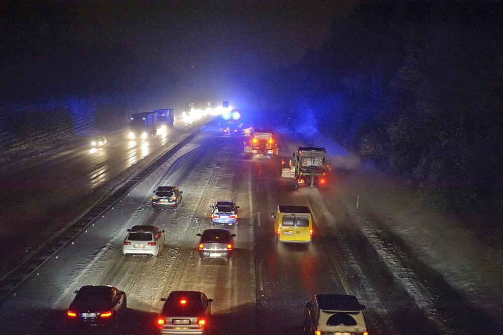 Winter service vehicles in service on the A8 motorway, Stuttgart junction near Stuttgart-Rohr, Baden-Wuerttemberg, Germany, Europe