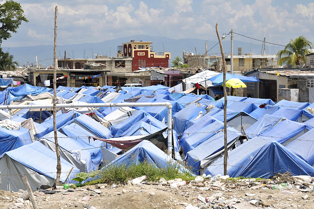 Temporary camp set up on a former football field, for refugees of the earthquake in January 2010, Port au Prince, Haiti, Central America