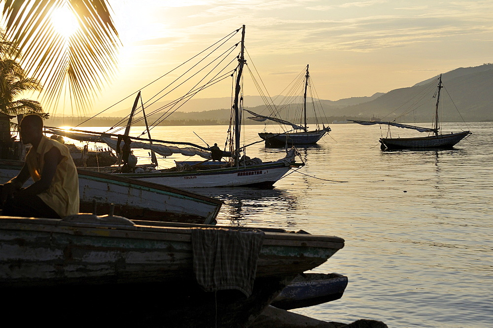 Fishing boats at sunset, fishing village on the Caribbean coast, Petit Goave, Haiti, Caribbean, Central America