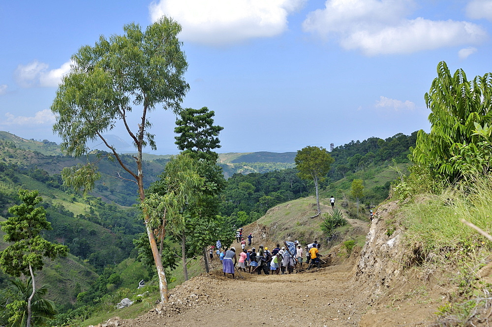 Inhabitants of a mountain village building a road with the assistance of an aid organisation, they want to link their village to the main road to allow economic development in the community, Bordes, Leogane, Ouest Department, Haiti, Caribbean, Central Ame