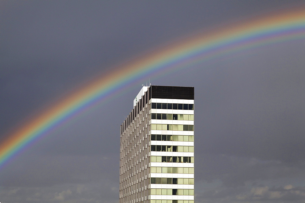 Rainbow above a high-rise building, Cologne, North Rhine-Westphalia, Germany, Europe