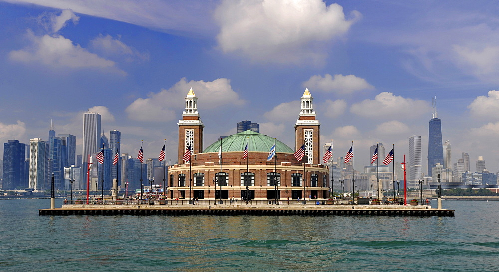 Navy Pier amusement park seen from Lake Michigan in front of the skyline with the John Hancock Center and the Aon Building, Chicago, Illinois, United States of America, USA