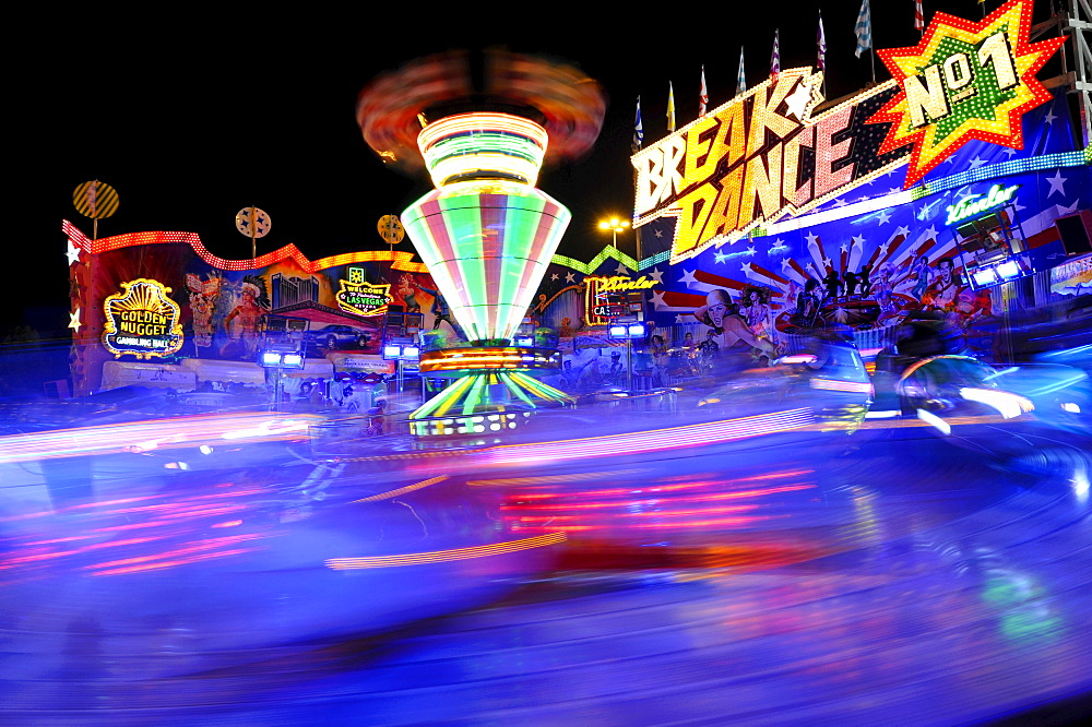Breakdance ride at night, carousel, motion blur, Cannstatter Wasen or Volksfest, Stuttgart Beer Festival, Wasen, Bad Cannstatt, Stuttgart, Baden-Wuerttemberg, Germany, Europe