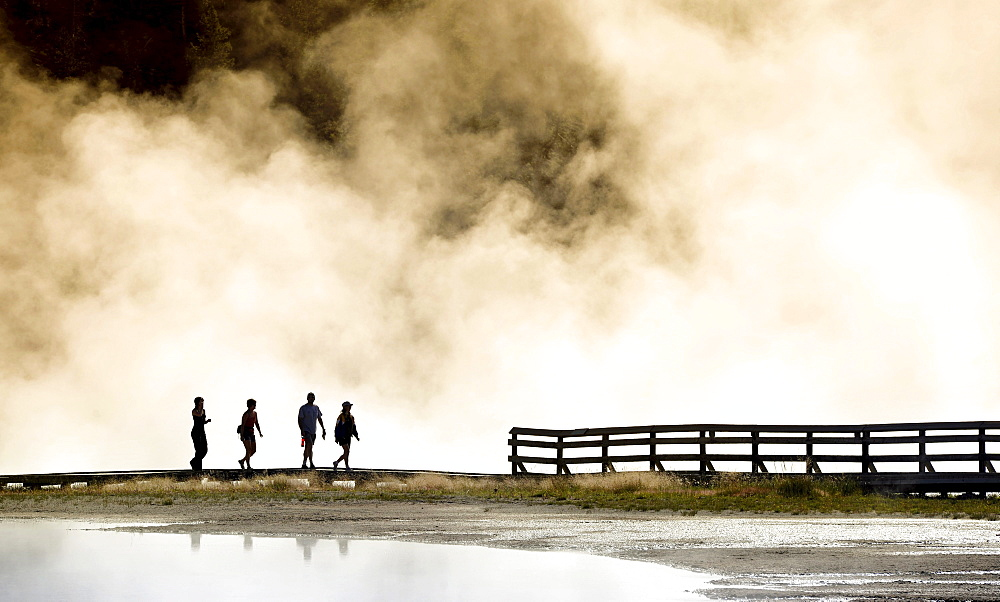 Tourists on boardwalk, steaming geothermal springs, geysers, Midway Geyser Basin, Yellowstone National Park, Wyoming, United States of America, USA