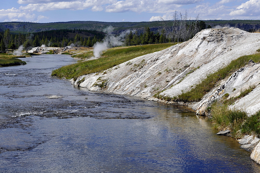View over Firehole River, Geyser Hill, Upper Geyser Basin, geothermal springs in Yellowstone National Park, Wyoming, United States of America, USA