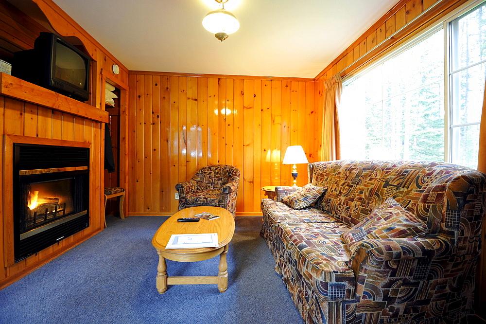 Interior view, living area, log cabin Becker Chalets, Jasper National Park, Canadian Rockies, Rocky Mountains, Alberta, Canada