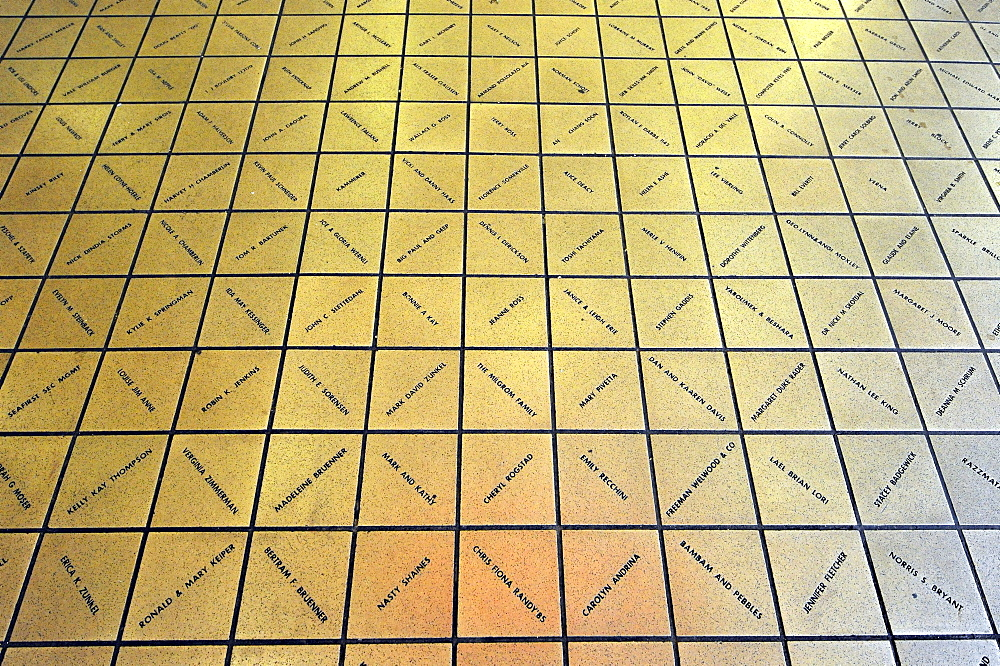 Sponsors names immortalized in bronze tiles from Rachel, the unofficial mascot, a lucky pig made of bronze, at the entrance of Pike Place Public Market, Seattle, Washington, USA