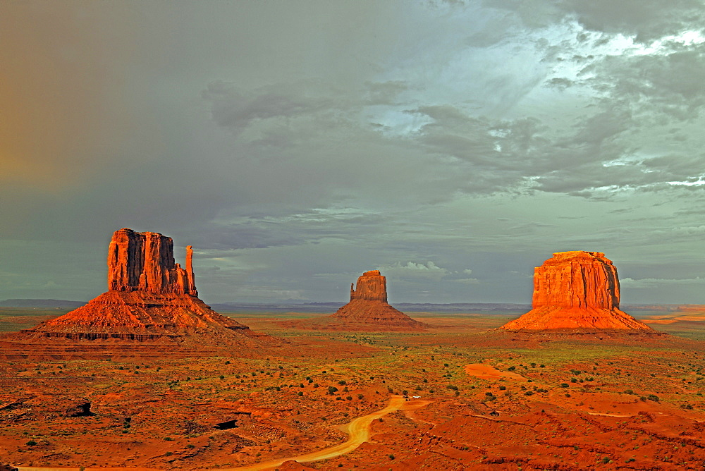 The Mitten Buttes in the last light during a storm, Monument Valley, Arizona, USA