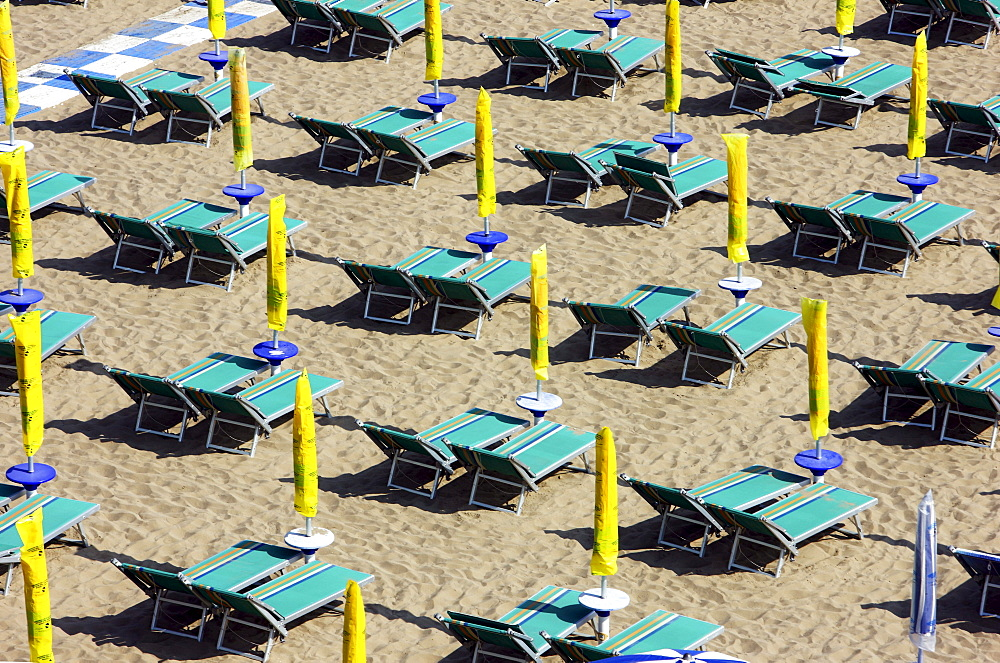 Parasols and empty sun loungers on the beach of Caorle, Adriatic Sea, Italy, Europe