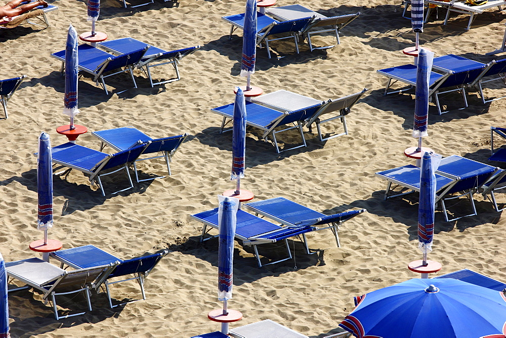 Parasols and empty sun loungers on the beach of Caorle, Adriatic Sea, Italy, Europerope