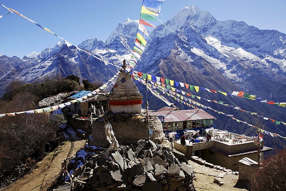A stupa with prayer flags at the Boudha Lodge in Mongla, Khumbu, Sagarmatha National Park, Nepal, Asia