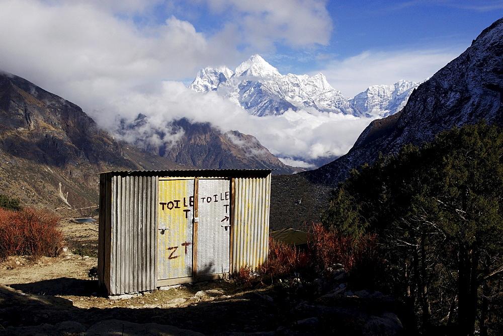 Toilets at the Buddhist monastery of Thame, behind Mt. Kangtega and Mt. Thamserku, Khumbu, Sagarmatha National Park, Nepal, Asia