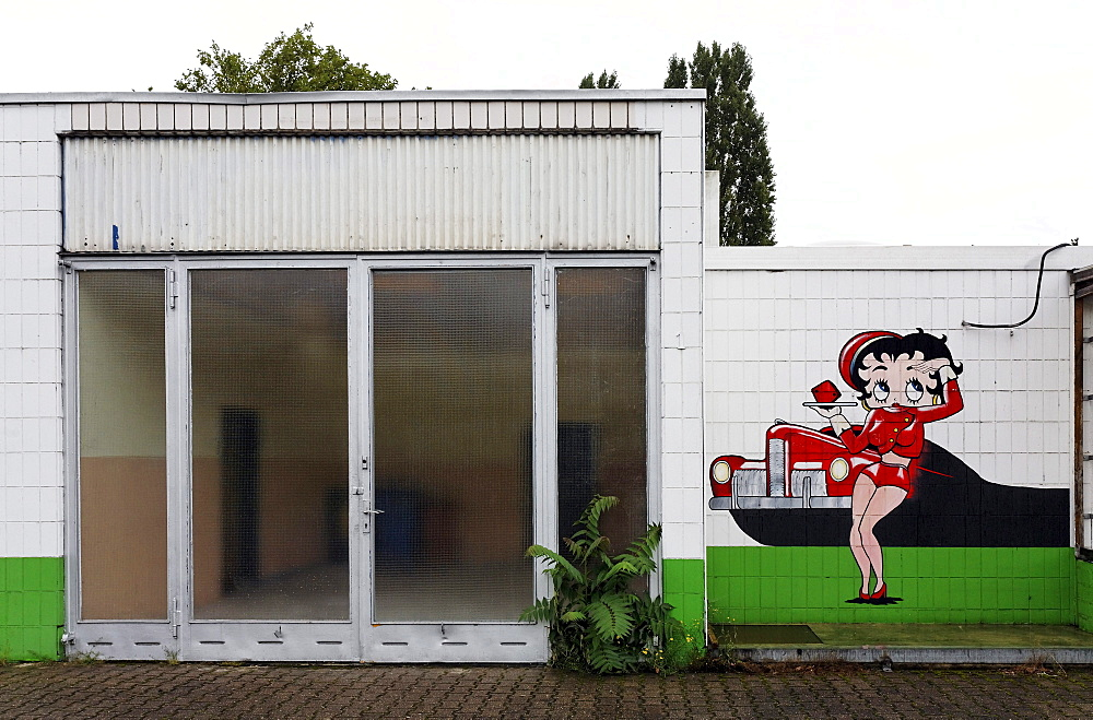 Abandoned car repair shop with a drive-in restaurant, advertising character painted on the wall, Krefeld, North Rhine-Westphalia, Germany, Europe