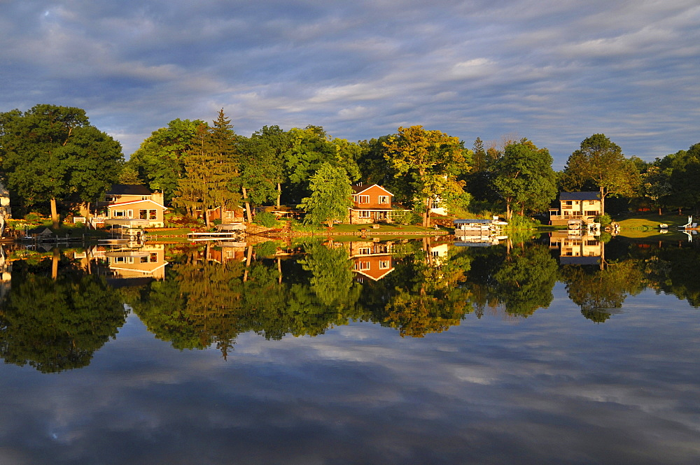 Houses reflected in the lake, Okauchee Lake, Wisconsin, USA