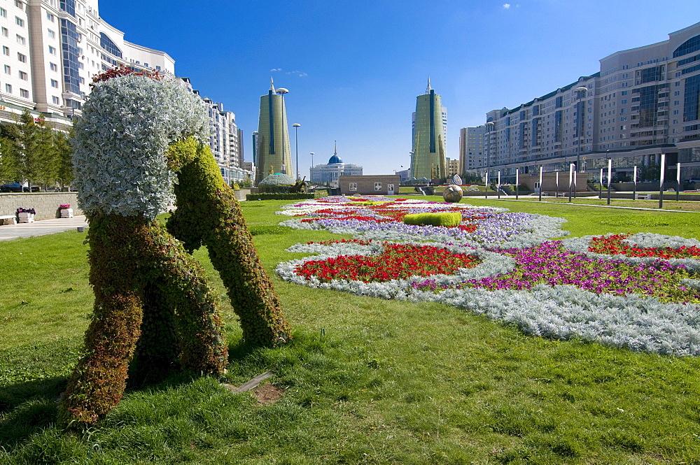 Flower beds at the Bayterek Tower, landmark of Astana, Kazakhstan, Central Asia