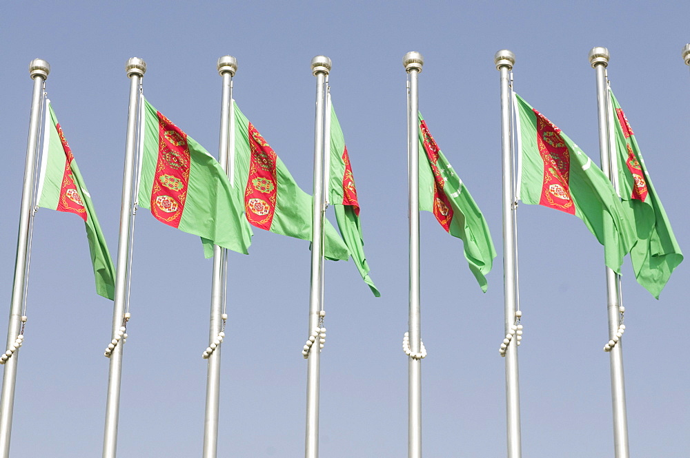 Turkmen national flags blowing in the wind, Ashgabat, Turkmenistan, Central Asia