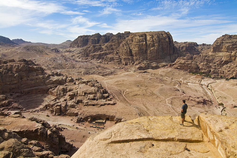 Man overlooking the ruins of the town of Petra, Jordan, Western Asia