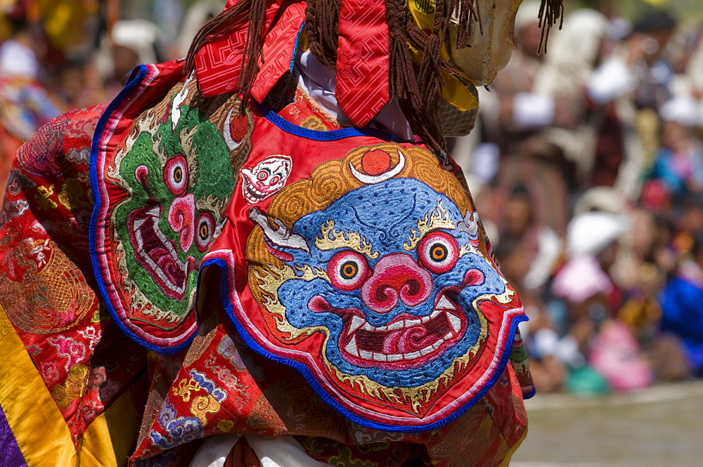 Close up of a traditional dress at religious festivity with male visitors and dances, Paro Tsechu, Bhutan, Asia