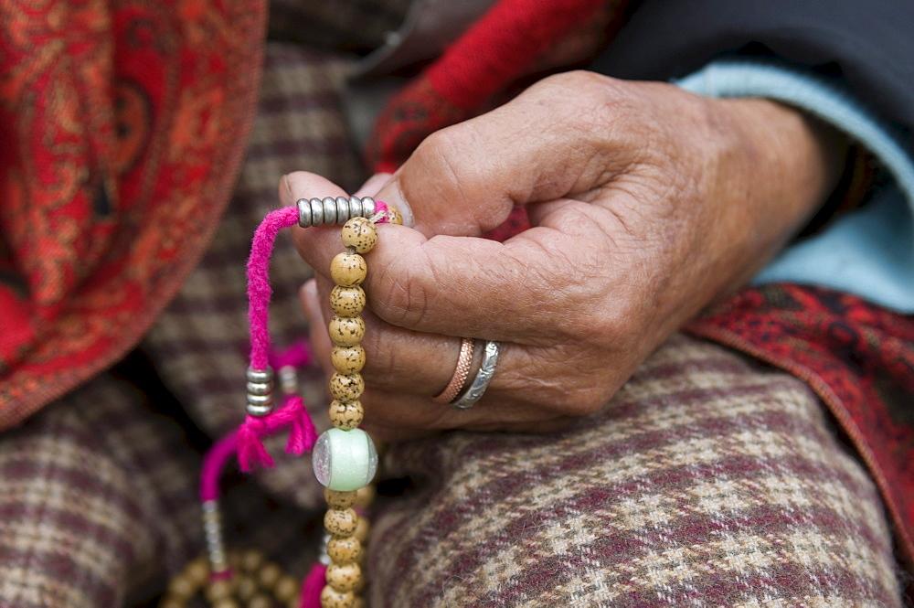 Buddhist pilgrim holding prayer beads, Thimpu, Bhutan, Asia