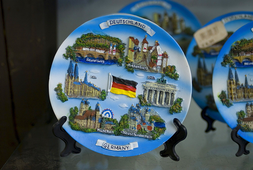 Plates depicting typical German sights in a souvenir shop, Germany, Europe