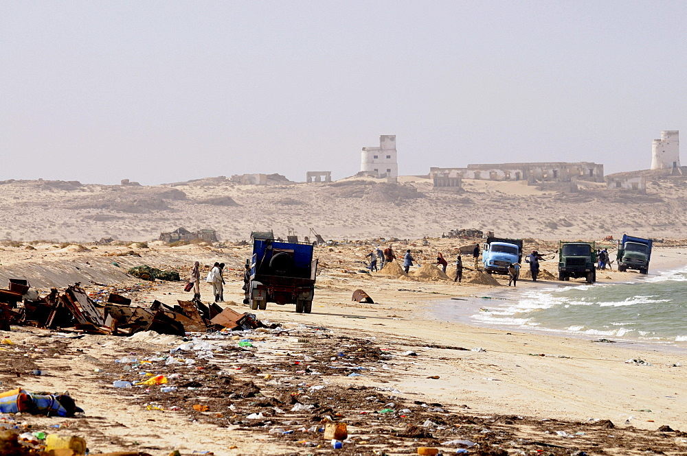 People collecting metal and other parts of rusting ships left over at the ship cemetery of Nouadhibou, Mauritania, Africa