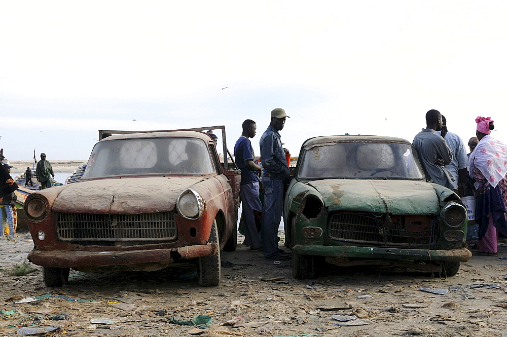 Very old rusting Peugeots on the fish market of Nouadhibou, Mauritania, northwestern Africa