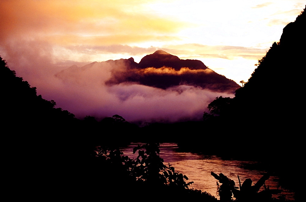 Misty mountains and river in the early morning, northern Laos, Asia