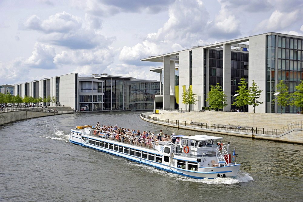 Passenger ship with tourists, Paul-Loebe-Haus building, river Spree at Schiffbauerdamm, Regierungsviertel government district, Berlin, Germany, Europe