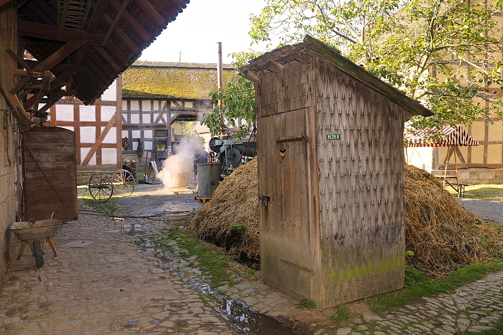 Outhouse, toilet next to the dung heap on a farm, Europa Park near Neu-Anspach, Hochtaunuskreis district, Hesse, Germany, Europe