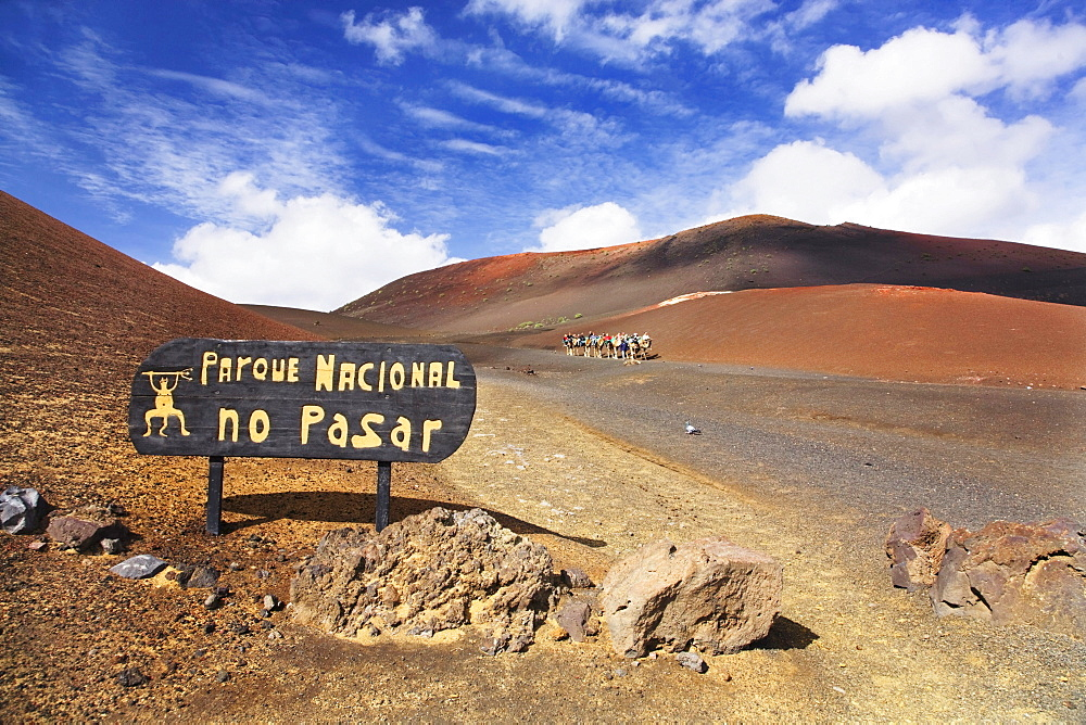 Sign, No Trespassing - National Park, in the back tourists riding dromedaries in the Timanfaya National Park, Lanzarote, Canary Islands, Spain, Europe