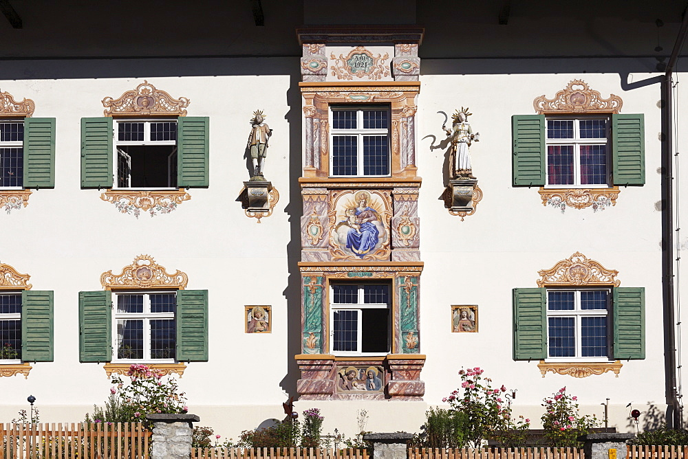 Facade of a villa built in Bavarian country house style in 1921, bay window with mural paintings called Lueftlmalerei, Fruehlingstrasse street, Garmisch district, Garmisch-Partenkirchen, Werdenfelser Land region, Upper Bavaria, Bavaria, Germany, Europe