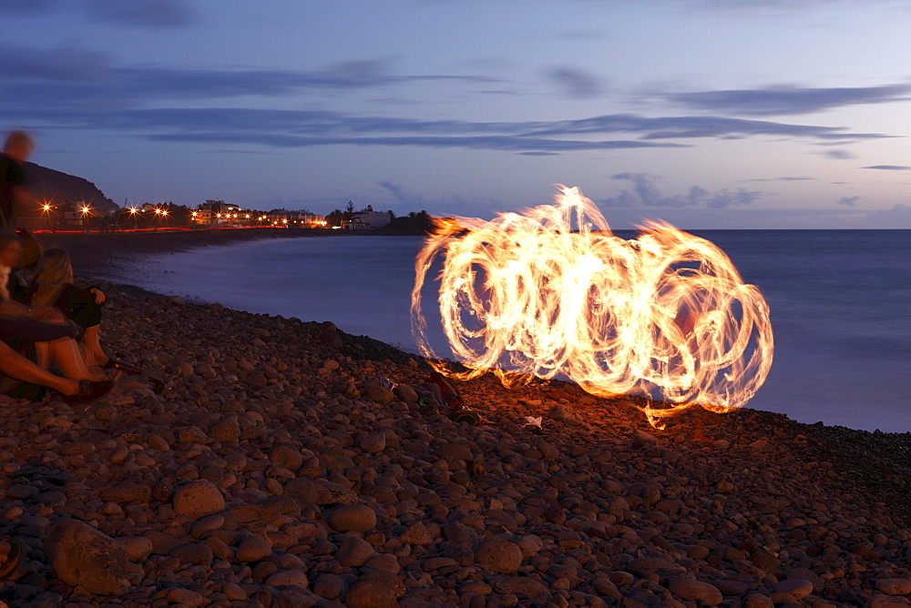 Fire dancer with torches, La Playa, Valle Gran Rey, La Gomera, Canary Islands, Spain, Europe